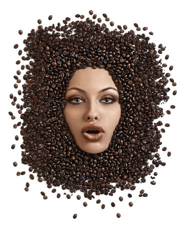 close up of young woman coming out with her pretty face from a lot of coffee beans with toned make up photo