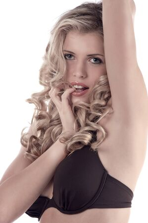breasts pretty: Sensual shot of a curly haired blonde girl wearing a bikini
