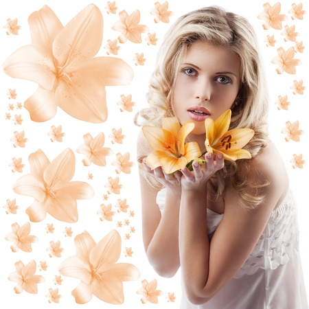 classic beauty portrait of young and beautiful woman with orange lily and blond curly hair on white background photo