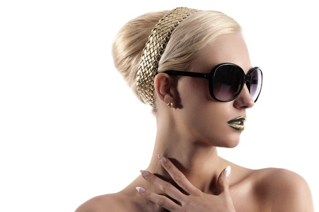 cute and attractive blond girl with sunglasse and hair style looking on one side photo