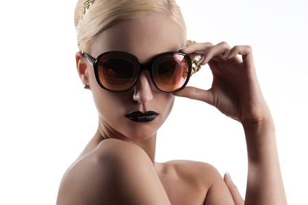 fashion portrait of young blond woman with hair style black lips and wearing gold sunglasses over white photo