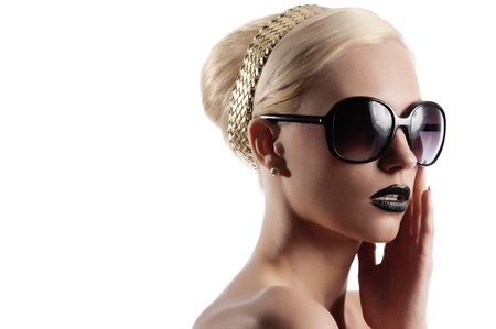 fashion portrait of young beauty woman with sunglasses and black lips looking surprised photo
