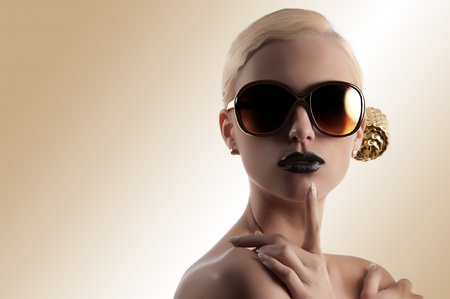 fashion portrait of young blond woman with hair style black lips and wearing sunglasses over white photo