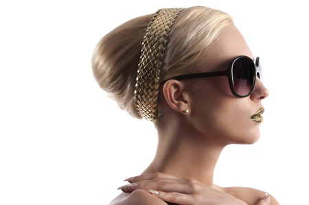 fashion portrait of young blond woman with hair style golden lips and wearing sunglasses over white photo