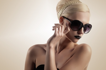 sunglasses isolated: beauty portrait of blond girl with hair style black lips looking down isolated over white