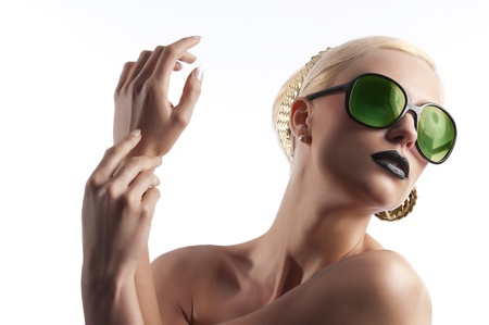 fashion portrait of young blond woman with hair style black lips and wearing green sunglasses over white photo