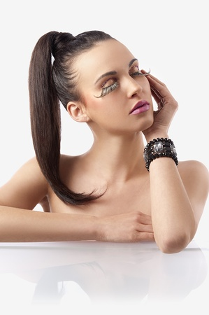 pony tail: portrait of pretty and sensual brunette with hair pony  tail and creative make up with long eyelashes posing