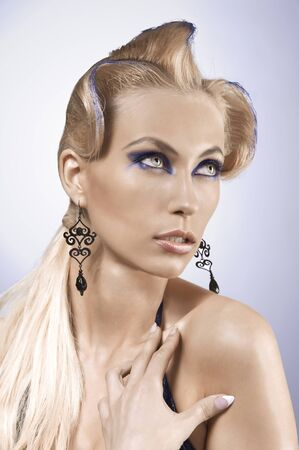 fantasy portrait of pretty blonde wearing a metallic blue make up photo