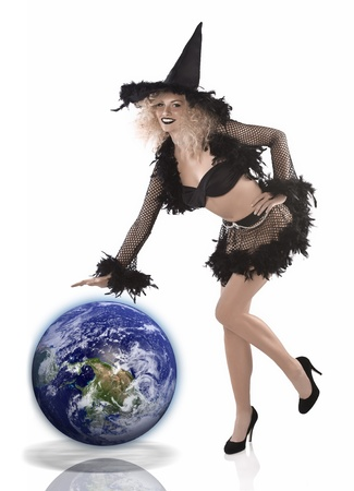 cute and natural looking girl posing for halloween wearing a black feathered witch costume and high heels photo