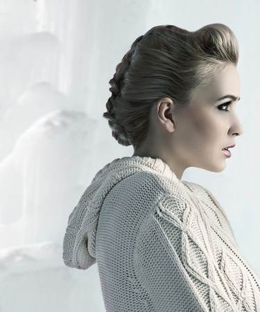 attractive beautiful blonde with a nice up do wearing a comfortable woolen sweater photo