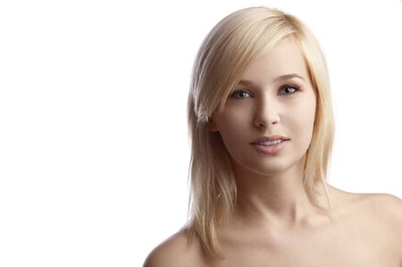 blond haired: beauty close up portrait of a young blond haired woman over white touching her in a very sweet way her face  Stock Photo
