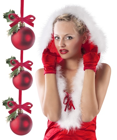 young and sexy woman in red santa claus dress with hood and white fur and gloves hidding under hood photo
