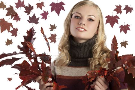 blonde natural girl holding red autumn leaves in her hand on white photo