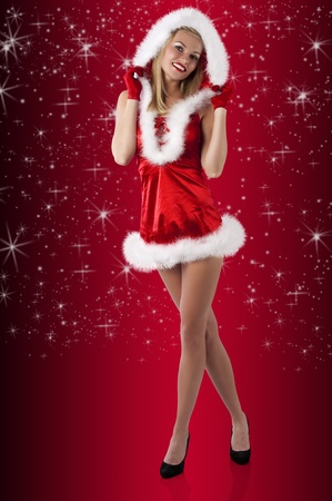 pretty and sensual blond woman in santa claus red dress posing a smiling with a nice hairstyle  photo
