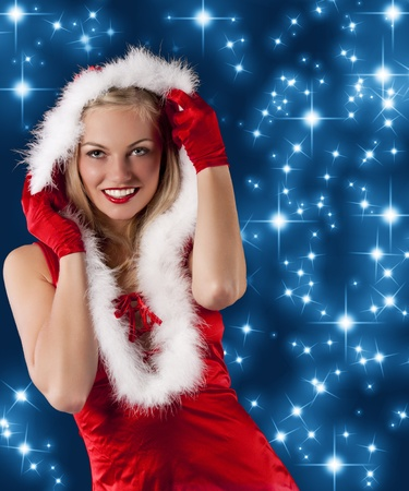 pretty and sensual blond girl in santa claus red dress posing a smiling with a nice hairstyle and hoody on photo