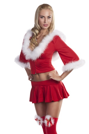 beautiful blonde girl in red christmas costume with mini skirt and party stockings with fur photo