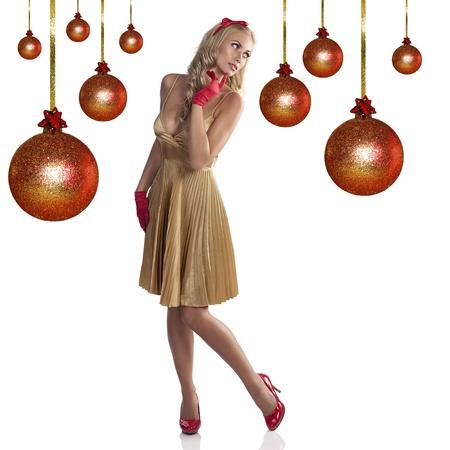 bow hair: moda navidad ni�a con un vestido de oro, guantes rojos y un mo�o rojo en el pelo largo y rubio