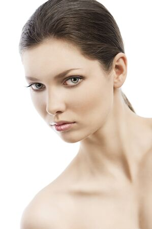 skewed: Beauty style portrait of young woman with healthy skin and wet hair . she is skewed to the and looks in to the lens, her face is turned of three-quarters