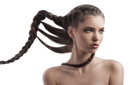 face shot of a beautiful brunette with a moving long braid hair style on white Stock Photo - 12047872