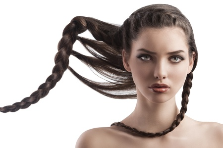 beauty portrait of a beautiful young woman with brunette hair and a creative hairstyle on white Stock Photo - 12047866