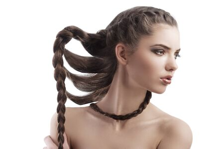 beauty profile shot of a beautiful brunette with long braided hair on white Stock Photo - 12047874