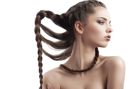 beauty profile shot of a young model with long braided hair on white photo