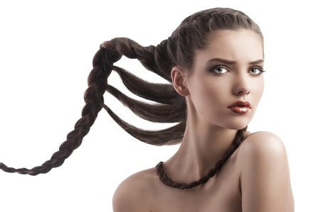 beauty face shot of a pretty brunette with long braided hair on white Stock Photo - 12047873