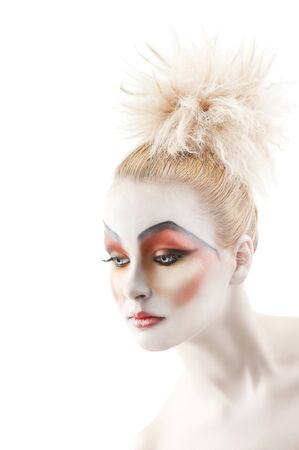 faceart: Portrait of young woman with colorful creative make-up like a doll and very cute hair style, she is turned of three quarters and looks down at right