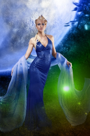draped: blonde attractive stunning woman with a long elegant leather dress and a  stole with creative make up and hair style on space background Stock Photo