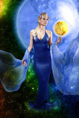 fantasy girl: attractive stunning woman with a long elegant leather dress and a  stole playing with golden planet on space background