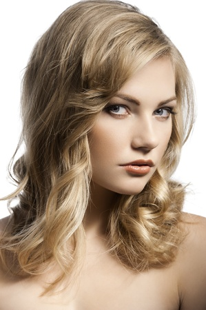 close up beauty portrait of a young and alluring blond girl with hair style over white photo