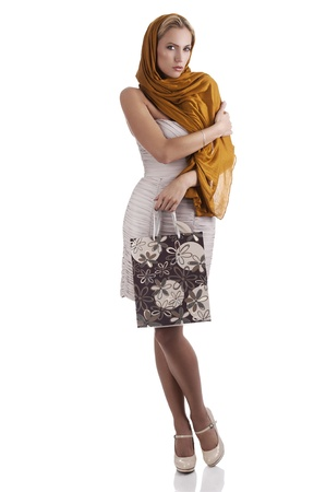 lovely elegant woman with scarf and flower textured shopping bag over white  photo