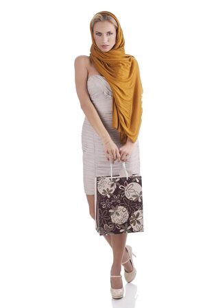 lovely alluring elegant woman with scarf and shopping bag over white  photo