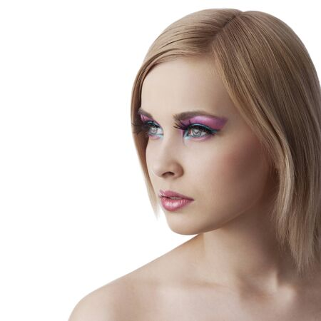 beauty portrait of blond young girl looking sideways with colourfull makeup and hair style isolated over white background photo