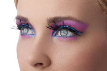 make up eyes: close up on the eyes of a beauty model with blue and pink  color creative make up