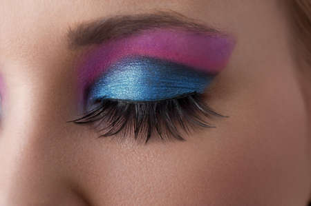 make up eyes: close up on the eye of a beauty model with colorful and creative make up