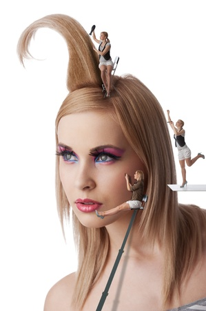 beauty portrait of blond young girl with her make up and creative hair style under costruction with little worker