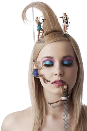 vogue style: beauty portrait with little make up artist MUA and hair styling HS working on the face model