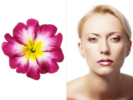 beauty young girl with a floral makeup. She is turned of three quarters and looks in to the lens with attractive expression photo