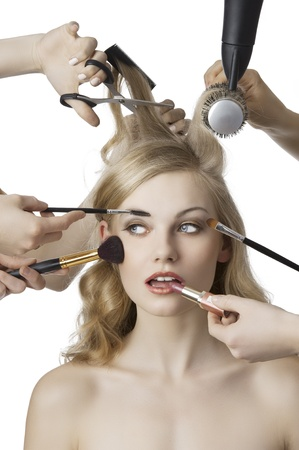 stylist: woman getting a beauty and hair style in the same time with hands making differente works Stock Photo