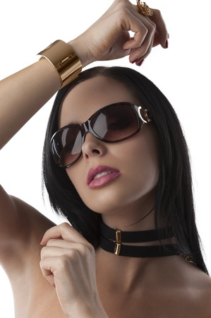 portrait of young and beautiful brunette with sunglasses and fashion jewellery over white taking pose photo