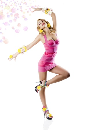 wind dress: Blond young woman wearing a pink summer dress