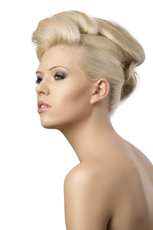 nude pretty girl: very pretty blonde woman with elegant hairstyle, she is turned of three quarters at right and looks in front of her with dreaming expression
