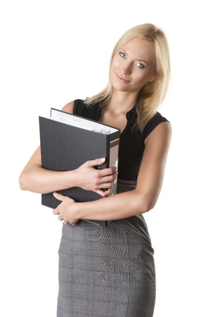 pretty business woman with elegant dress and classifier, she looks in to the lens with classifier in her arms and smiles photo