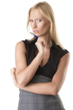 classifier: pretty business woman with elegant dress and pen, she looks in to the lens with serious expression, she takes the pen near the chin Stock Photo