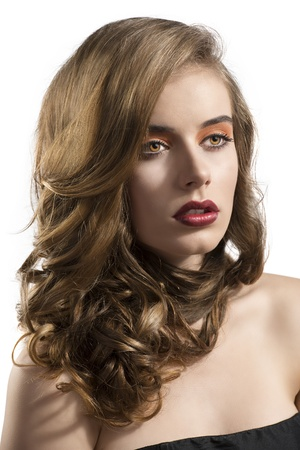 pretty girl with wavy hair and red lipstick, she is turned of three quarters at left and looks in front of her Stock Photo - 15785120