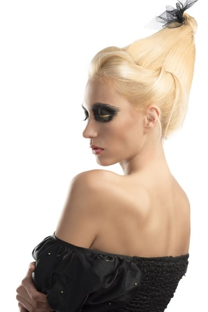 nacked: pretty blonde girl with creative dark make-up and upward hairstyle, she is turned back and shows her nacked left shoulder