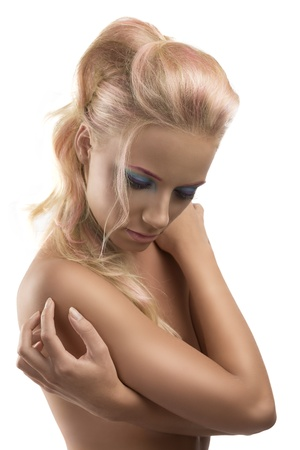 young girl nude: pretty  girl with blonde long hair and coloured make-up, she looks down with crossed arms
