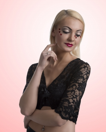 prety: prety blonde girl with sexy clothing and heart shaped decoration on the face Stock Photo