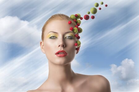 very pretty blonde girl with different spheres color on the face doing a creative make up Stock Photo - 18971535
